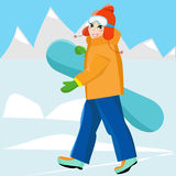 Young girl snowboarder with snowboard in the hands. Leisure. Winter sport. Holidays in the mountains. Snowboarder is on the top of a snowy ski the mountain, in a Stock Images