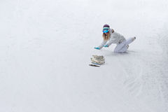 Young girl snowboarder snowboarding released from the hands down the mountain Stock Image