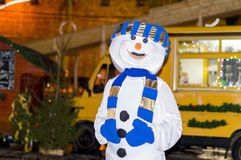 A young girl in a snowman costume with a blue scarf, celebrates the new year 2018 royalty free stock image