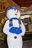 A young girl in a snowman costume with a blue scarf, celebrates the new year 2018 stock illustration
