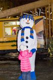 A young girl in a snowman costume with a blue scarf, celebrates the new year 2018 royalty free stock photo