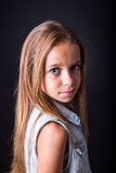 Young girl with sober look on black background Royalty Free Stock Photos