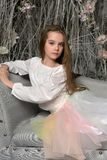 Young girl on the sofa. In a dreamlike interior Royalty Free Stock Photo
