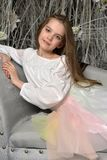 Young girl on the sofa. In a dreamlike interior Stock Photo