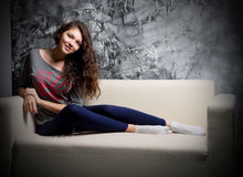 Young girl on sofa Royalty Free Stock Photography