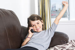 Young girl in a sofa. A Young girl in a sofa  with phone Stock Image