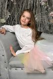 Young girl on the sofa. In a dreamlike interior Royalty Free Stock Photography