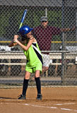Young Girl Sofball player at Bat royalty free stock image