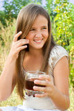 Young girl with soft drink Stock Photos