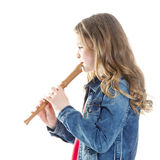 Young girl with soprano recorder. And white background stock image