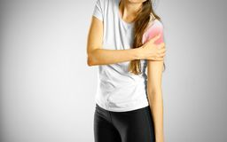 A young girl sore arm. The pain in my arm. The location of the p. Ain marked in red stock photography