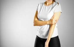 A young girl sore arm. The pain in my arm. The pain is marked in. A young girl sore arm. The pain in my arm stock images