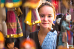 Young girl in a souvenir shop in Kathmandu. Travel. Royalty Free Stock Photography