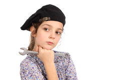 Young girl with a spanner Stock Image