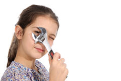 Young girl with a spanner Royalty Free Stock Photos