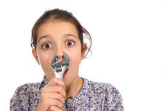 Young girl with a spanner Stock Photo