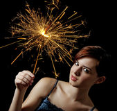 Young girl with a sparkler. Black background Royalty Free Stock Photography