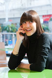 Young girl speaking on a mobile Stock Photo