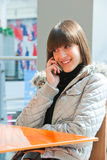 Young girl speaking on a mobile Royalty Free Stock Image
