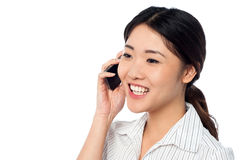 Young girl speaking over cell phone Royalty Free Stock Photo