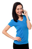 Young girl speaking over cellphone Royalty Free Stock Images