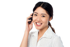 Young girl speaking over cellphone Royalty Free Stock Photo