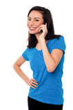 Young girl speaking over cellphone Stock Image
