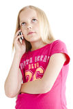 Young girl speaking on the phone. Over white background Stock Photography