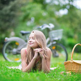 Young girl spending her time in the countryside Stock Images