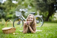 Young girl spending her time in the countryside Stock Image