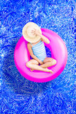 Young girl spending a relaxing day in the pool Stock Photos