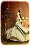Young girl spinning in a dress. A young girl spinning in a ball gown, photo in vintage style Stock Photos