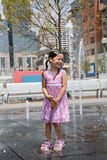 Young Girl at a Splash Fountain Stock Images