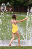 Young Girl at Splash Pad Stock Photos
