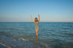Young girl splashing the water in the sea Stock Images