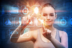 The young girl in sports concept pressing virtual buttons Stock Images