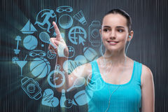 The young girl in sports concept pressing virtual buttons Royalty Free Stock Photos