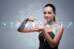 The young girl in sports concept pressing virtual buttons Royalty Free Stock Photography