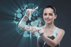 The young girl in sports concept pressing virtual buttons Stock Photography