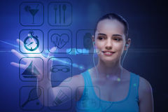 The young girl in sports concept pressing virtual buttons Royalty Free Stock Photo