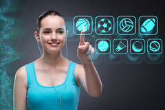 The young girl in sports concept pressing virtual buttons Stock Photos