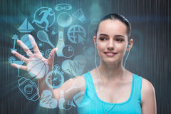 The young girl in sports concept pressing virtual buttons Stock Photo