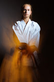 Young girl in a sports kimono in the image of judo. Royalty Free Stock Photo