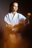 Young girl in a sports kimono in the image of judo. Stock Image