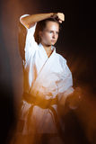 Young girl in a sports kimono in the image of judo. Royalty Free Stock Images