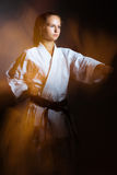 Young girl in a sports kimono in the image of judo. Royalty Free Stock Photography
