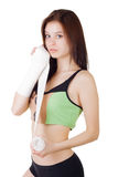 Young girl in a sports tank top and shorts is bandaging his arm with an elastic bandage Royalty Free Stock Images