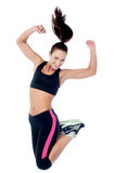 Young girl in sportswear jumping with joy Royalty Free Stock Photos