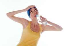 Young girl the sportswoman drinks water from a bot Royalty Free Stock Images