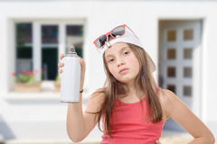 Young girl with a spray can Royalty Free Stock Photo